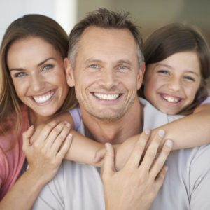Family with beautiful smiles after a dental consultation.